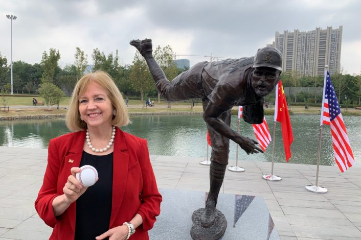 Mayor Lyda Krewson gifts bronze statue of Cardinals player Adam Wainwright to St. Louis sister city Nanjing, China.